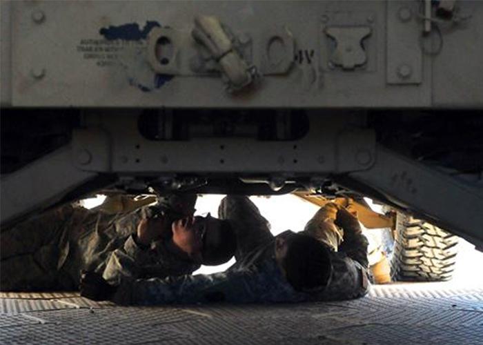 US Air Force Airmen Repairing Vehicle