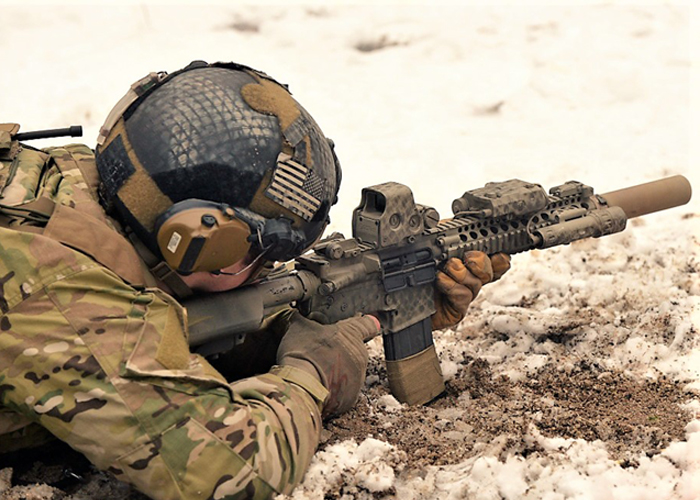 U.S. Army Soldier with Suppressed M4A1 Rifle
