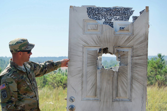 ... entering a room as the blast of the grenade can trigger off the explosive used for the booby trap or disorient or even injure the enemy behind the door. & U.S. Army Tests 40mm Door-Breaching Grenade From Chemring Ordnance ...