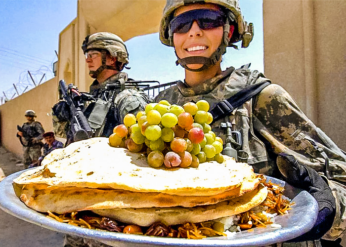 U.S. Army Sgt. Alyson Brown with a Platter of Food (U.S. Navy photo by Petty Officer 1st Class Mario A. Quiroga)
